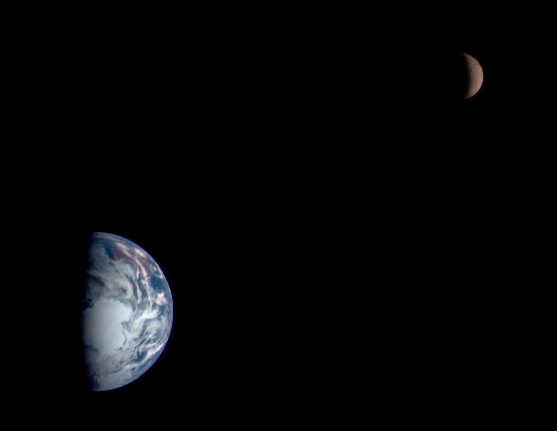 The Earth and Moon, seen by the NEAR-Shoemaker spacecraft in 1998 on its way to rendezvous with the asteroid Eros. Credit: NEAR Spacecraft Team, JHUAPL, NASA