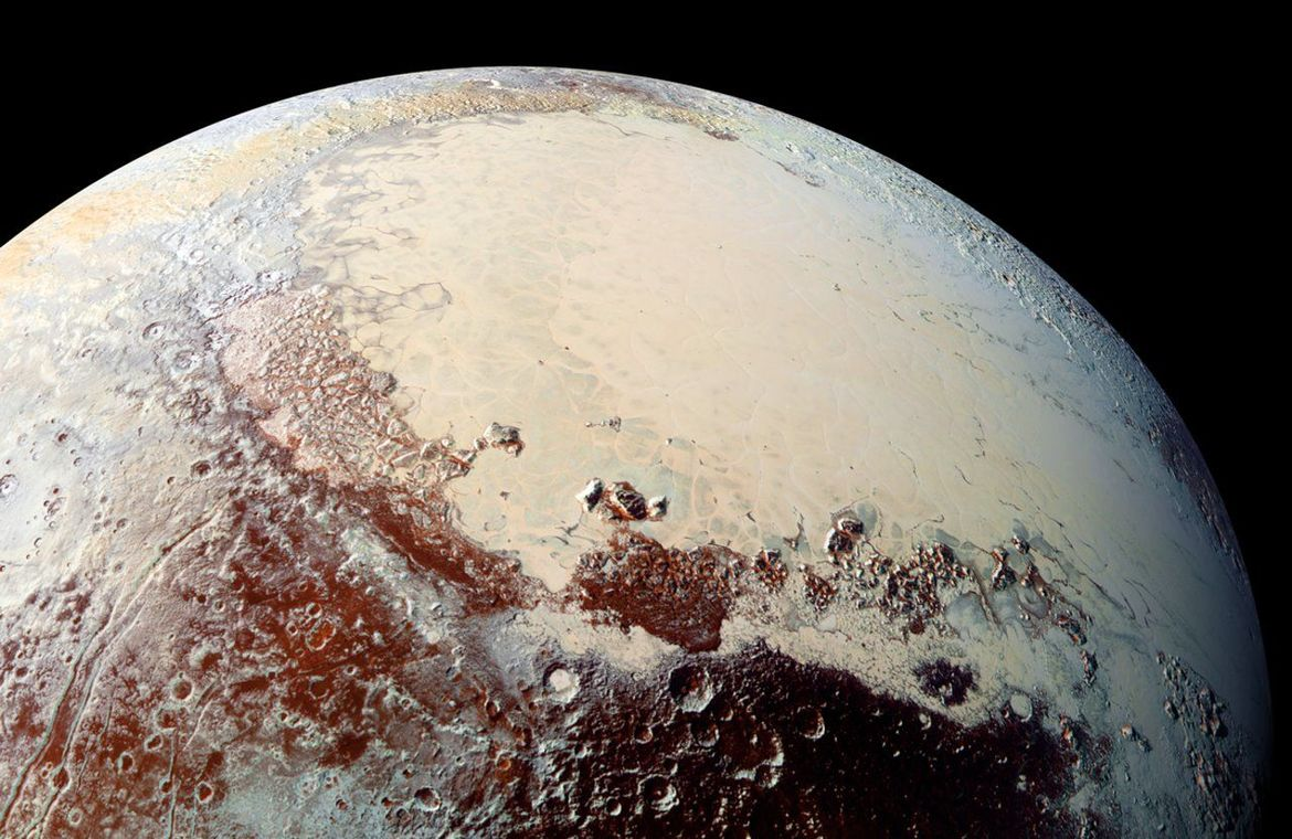 "Color image of Sputnik Planum, the western lobe of Pluto's ""heart"", showing that it's smooth and craterless, implying some process has repaved it. Credit: NASA/Johns Hopkins University Applied Physics Laboratory/Southwest Research Institute"