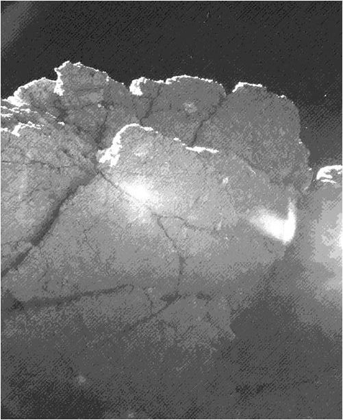 """The """"perihelion cliff"""" rock as seen by Philae, rotated to the same orientation as the images of Philae from Rosetta. Credit:ESA/Rosetta/Philae/CIVA via Nine Planets"""