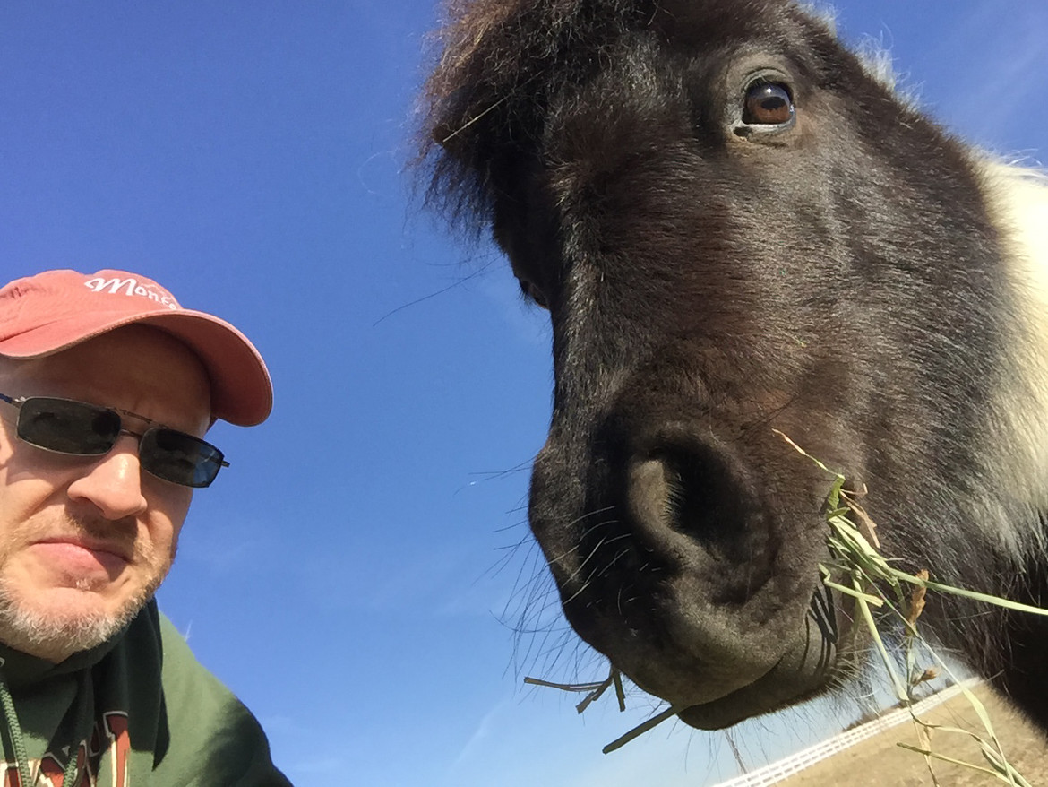 Your host and the littlest equine, Tiny Elvis. Credit: Phil Plait