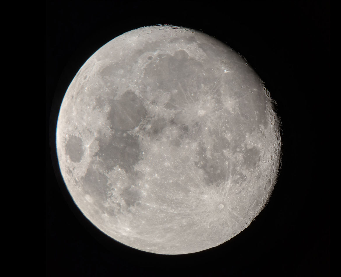"The gibbous Moon, taken on September 22 using a Celestron 8"" telescope and my cell phone mounted to the eyepiece. Credit: Phil Plait"