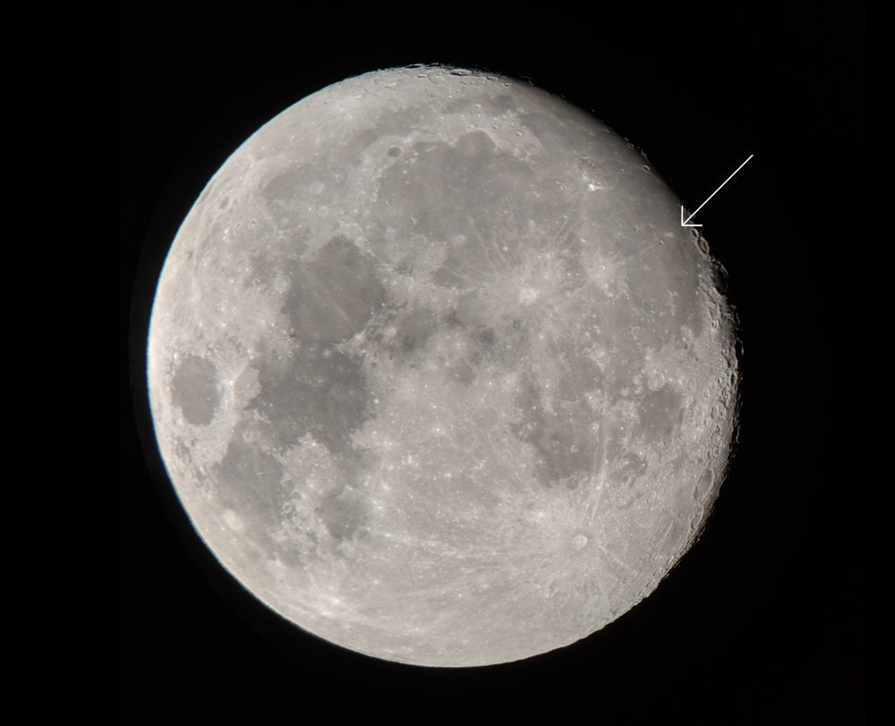 """The gibbous Moon, taken on September 22 using a Celestron 8"""" telescope and my cell phone mounted to the eyepiece. The Lunar Swirl, Reiner Gamma, is indicated. Credit: Phil Plait"""