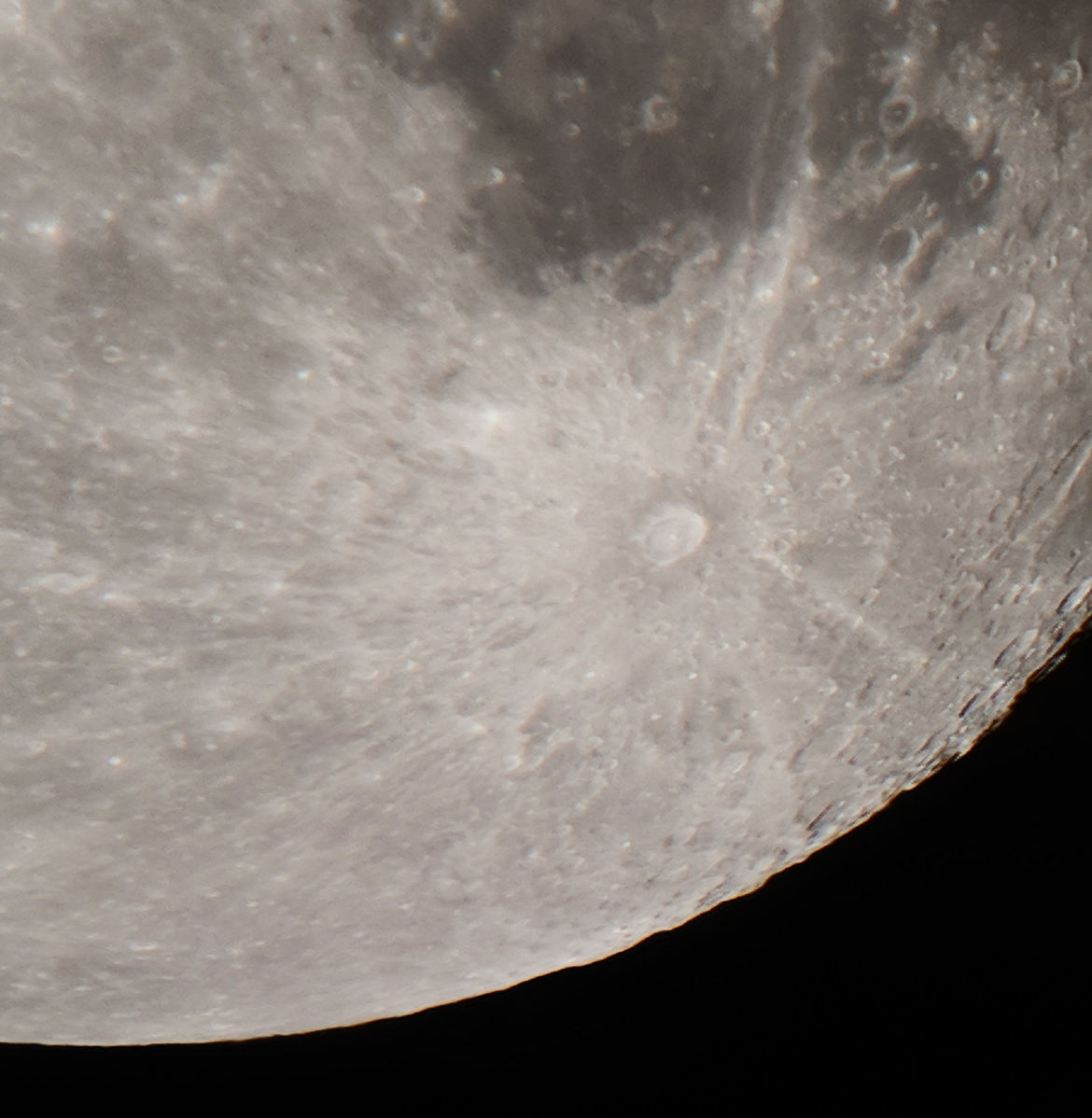 The huge lunar crater Tycho has a tremendous ray system reaching over a thousand kilometers, collapsed plumes from the impact that formed it. Credit: Phil Plait