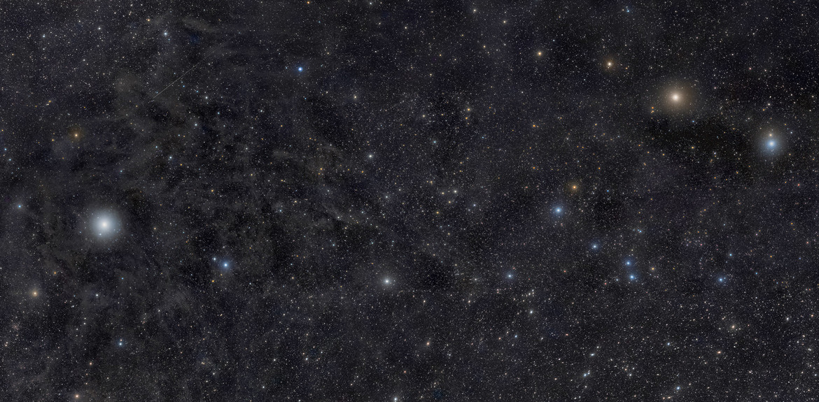 Ursa Minor — the Little Dipper — is gorgeous in this deep mosaic that shows thousands of stars, faint wisps of dust, and a brief interplanetary visitor. Credit: Rogelio Bernal Andreo