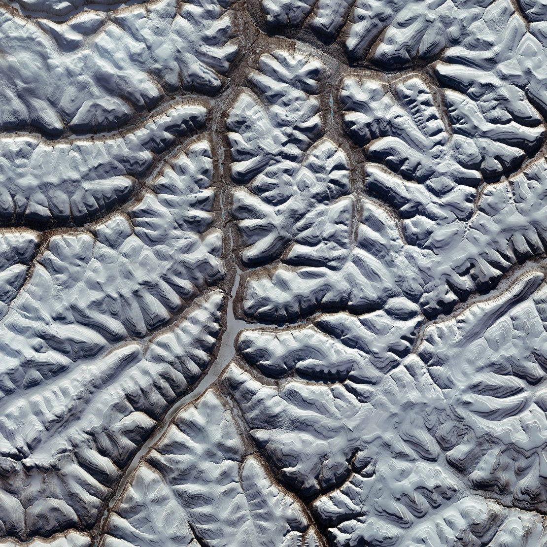 When flipped upside-down, our brains interpret this Sentinel-2A images correctly, and the lake appears as a depression while the flat-topped hills pop out. Credit: ESA
