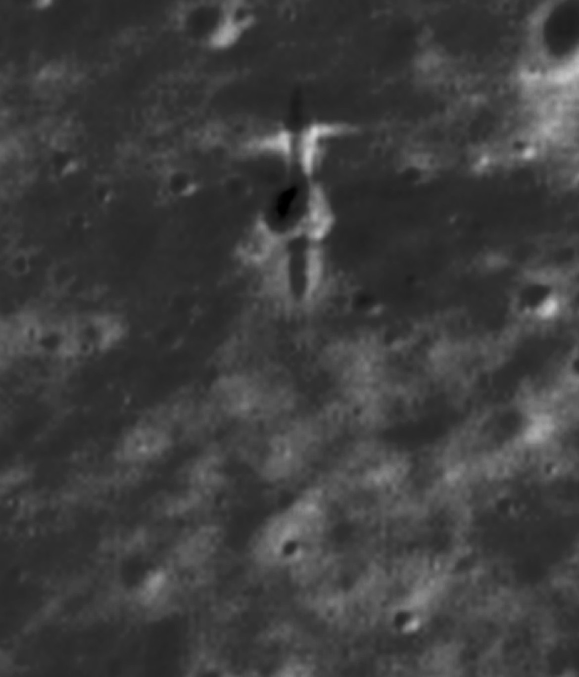 The impact site of SMART-1 observed by LRO. The Sun was to the west (left), so the crater's and gouge's right sides are illuminated. The image is about 50 meters wide. Credit: P. Stooke/B. Foing et al. 2017/ NASA/GSFC/Arizona State University