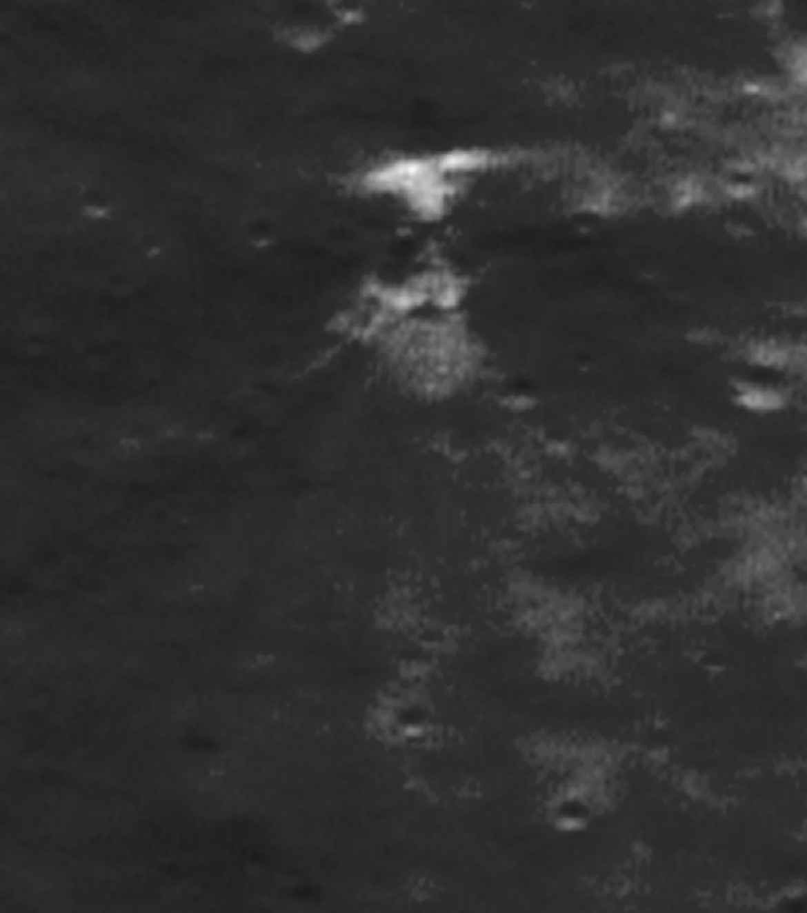 The SMART-1 impact site, this time when the Sun was shining straight along the gouge, highlighting brightness differences.