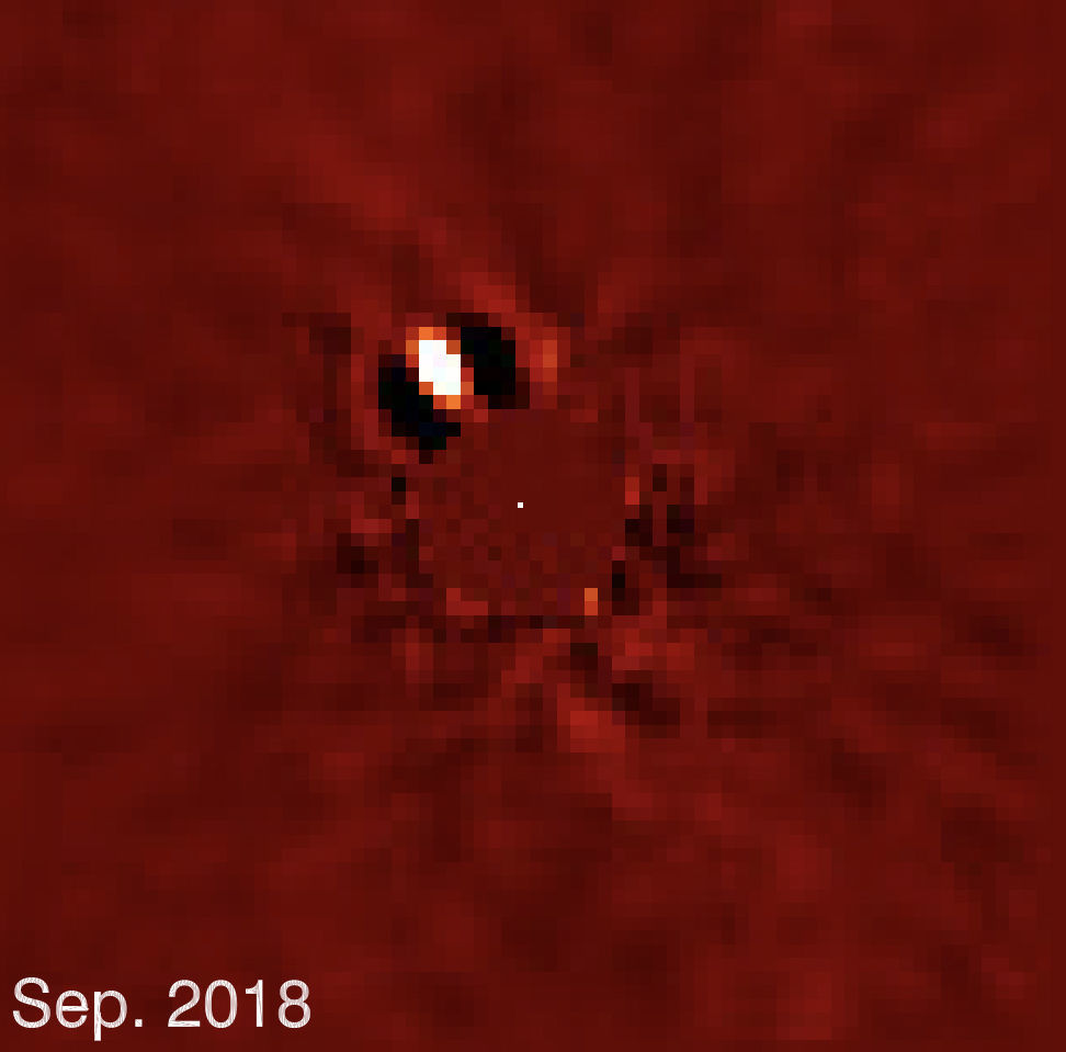 The exoplanet Beta Pictoris b, a super-Jupiter still glowing with heat leftover from its birth, re-emerges from the glare of its host star as it orbits. Credit: Lagrange, et al.