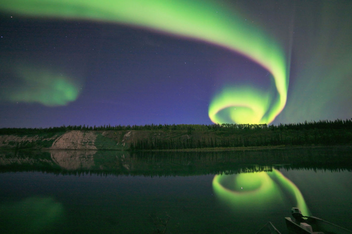 A curling, spiral aurora; the result of solar wind combined with Earth's magnetic field.