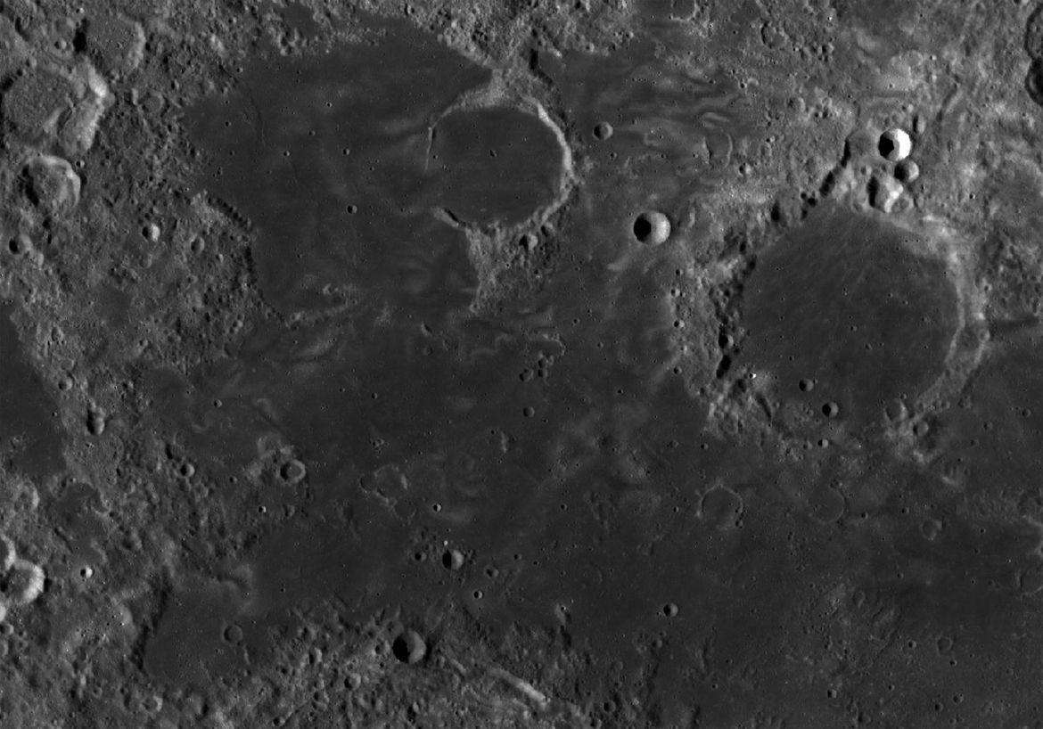 "Lunar swirls in Mare Marginis (literally, ""Margin or Border Sea"", since it's on the edge of the Moon's near side). Credit: NASA/GSFC/Arizona State University"