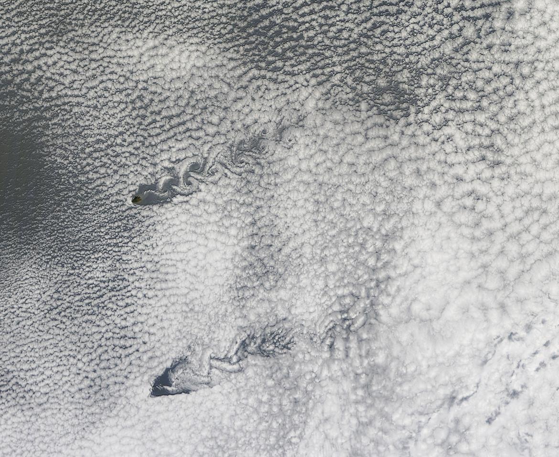 A pair of parallel von Kármán vortices shed off of Pacific islands. Click to embiggen. Credit: NASA/Jeff Schmaltz/LANCE MODIS Rapid Response