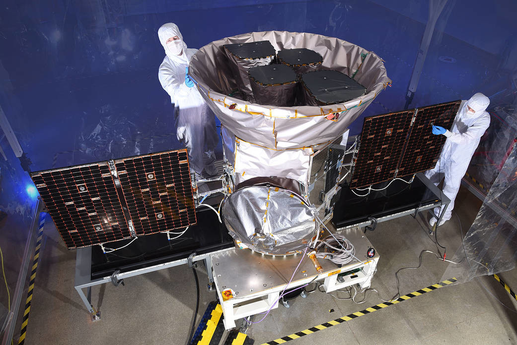 The TESS observatory being cared for by technicians before launch. Credit: NASA