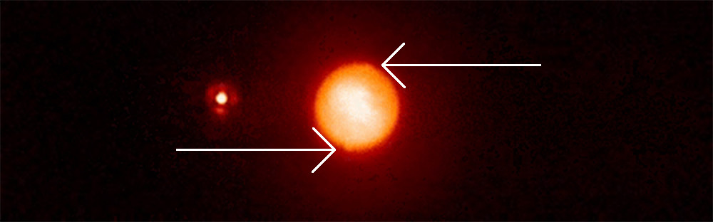 During the second star's transit, two refraction spots appear on opposite sides of Titan. Credit: Bouchez et al.
