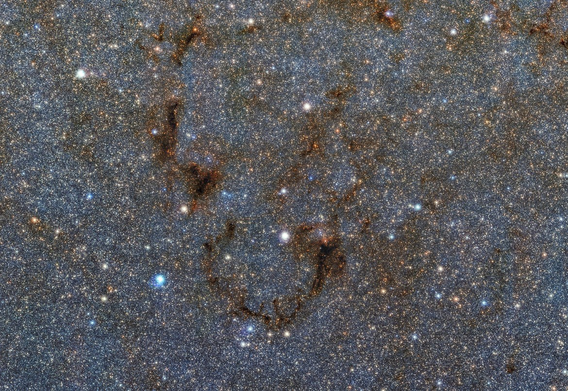 A small section of a much larger mosaic zooms in a single filament of dust many light years long. Credit: ESO/VVV Survey/D. Minniti & Acknowledgement: Ignacio Toledo