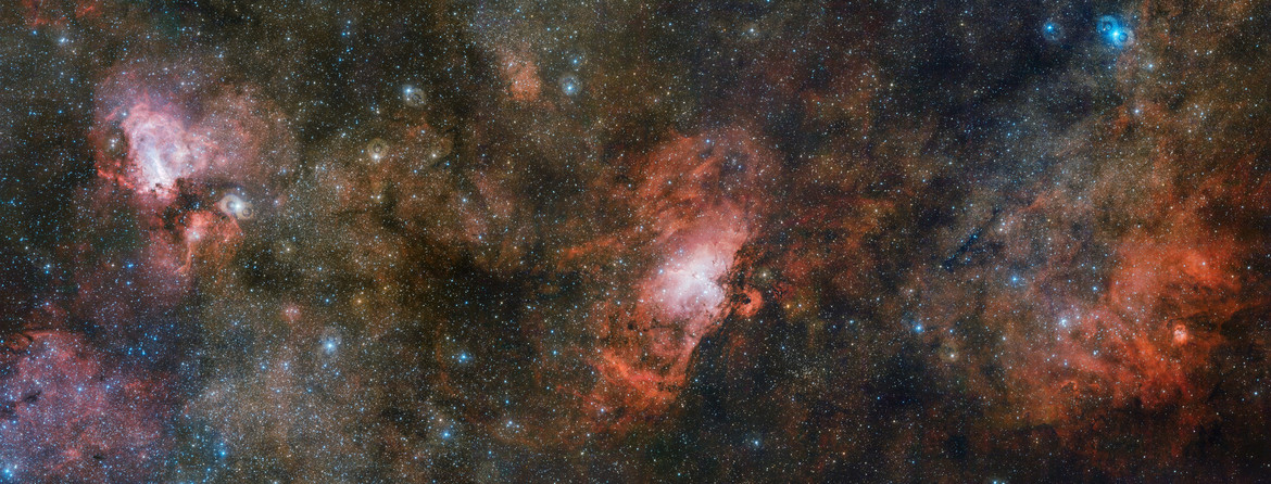 The Omega Nebula (Left), Eagle Nebula (middle), and Sharpless 2-54 (right), a sprawling collection of nebulae seen in a single huge mosaic. Credit: ESO