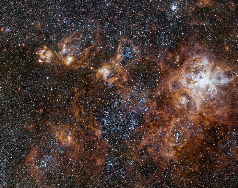 vlt_taThe hugely sprawling Tarantula Nebula, a vast star-forming complex in a nearby satellite galaxy of the Milky Way. Credit: ESOrantula_2500
