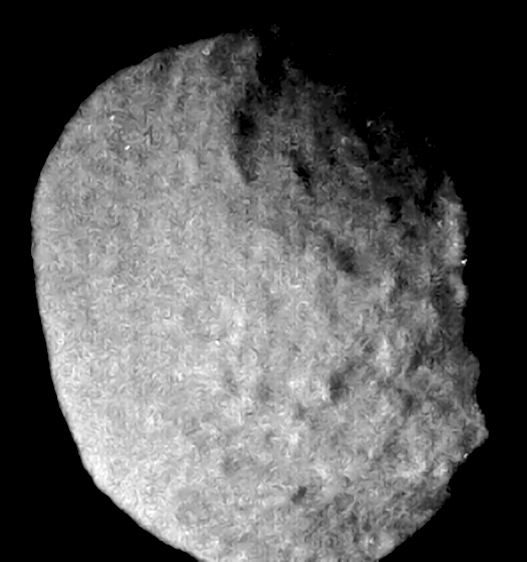 An image of Neptune's moon Proteus, taken by Voyager 2 in 1989. The huge crater Pharos can be seen to the upper right. Credit: NASA/JPL-Caltech/Kevin M. Gill