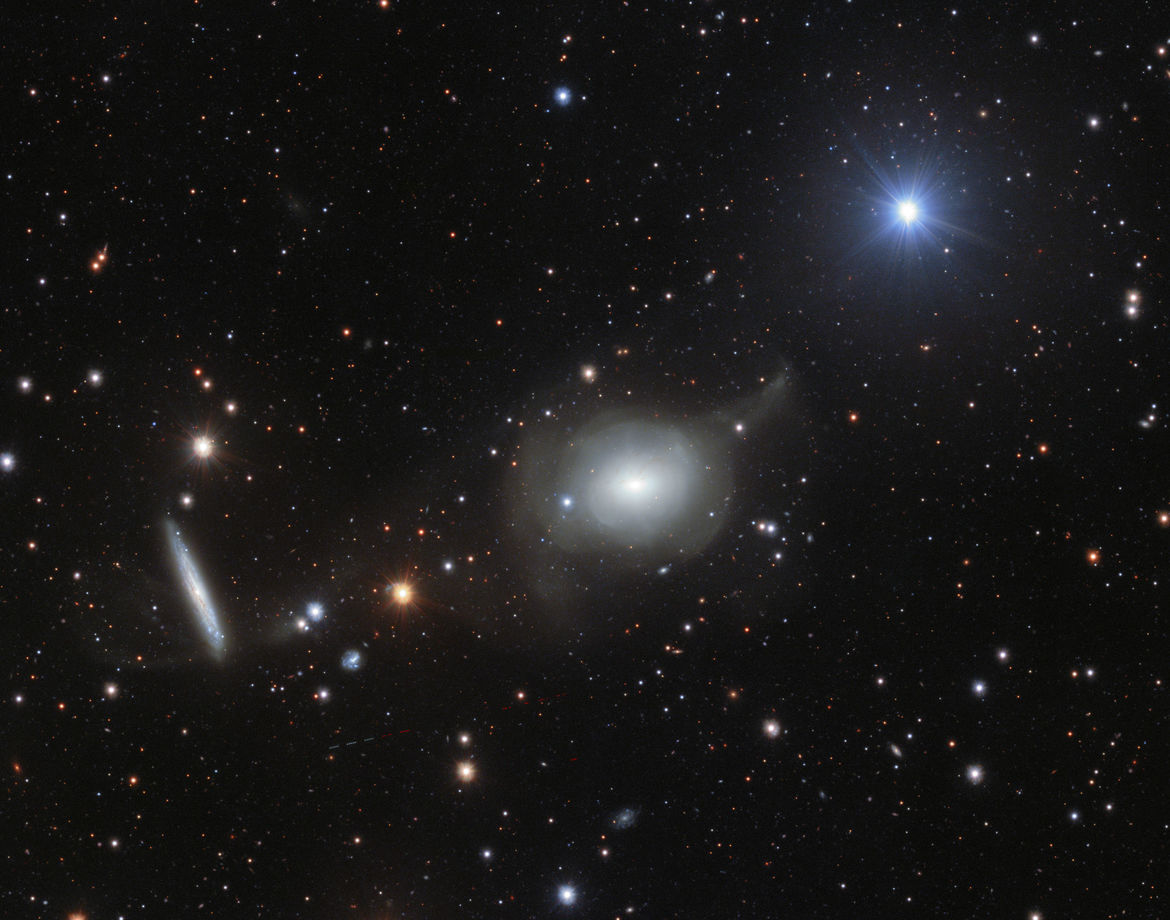 NGC 5018 and environs. Classified as an elliptical galaxy, there's clearly more going on with this odd object. Credit: ESO/Spavone et al.