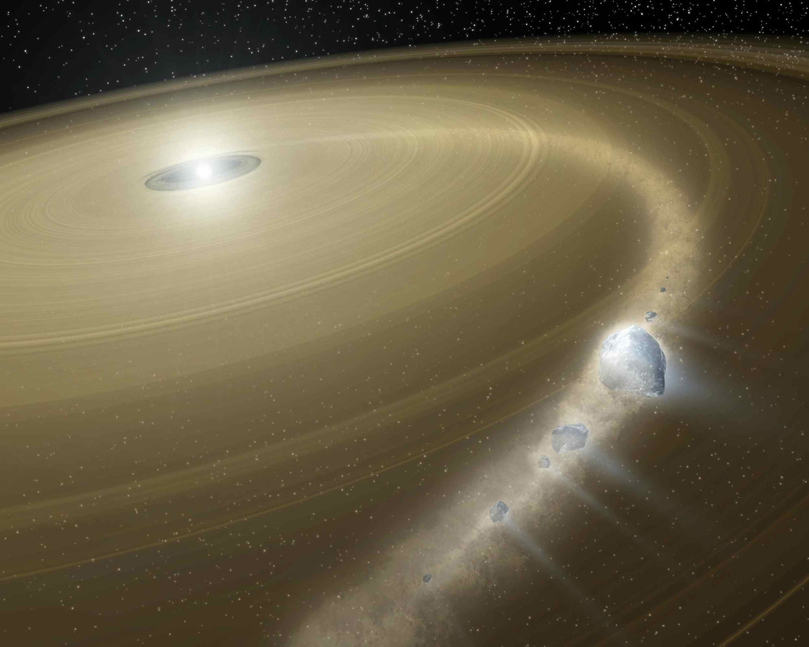 An artist's rendering of a comet (which is very similar to an asteroid) getting torn apart near a white dwarf. Many white dwarfs have rings of dust around them as well, more evidence of a planetary system orbiting them. Credit: NASA/JPL-Caltech