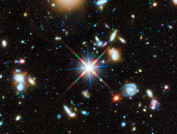 A small section of the Hubble ultraviolet portion of the Ultra Deep Field. That bright thing is a star in our own galaxy. Pretty much everything else in this shot is a whole galaxy, very very far away. Credit: NASA,ESA, H. Teplitz and M. Rafelski (IPAC/Ca