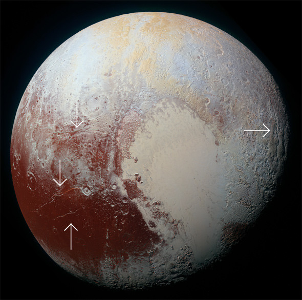 Arrows indicate huge cracks in Pluto's surface, possibly due to a liquid water ocean under the surface causing expansion. Credit: NASA/JHUAPL/SwRI