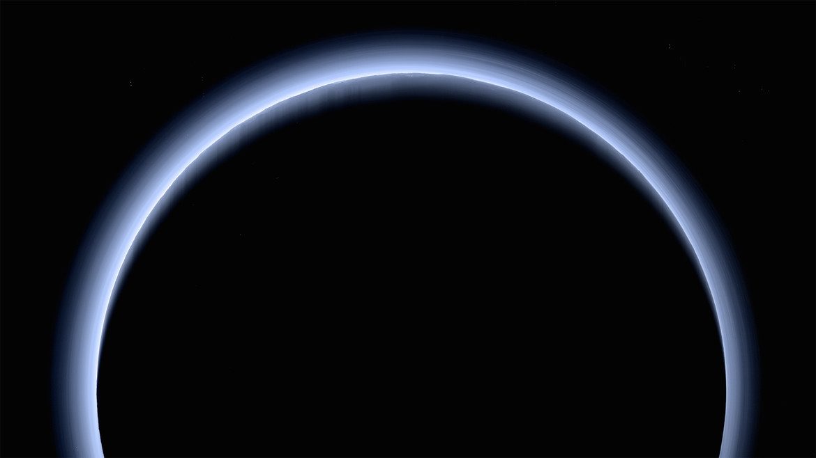 Pluto backlit by the Sun