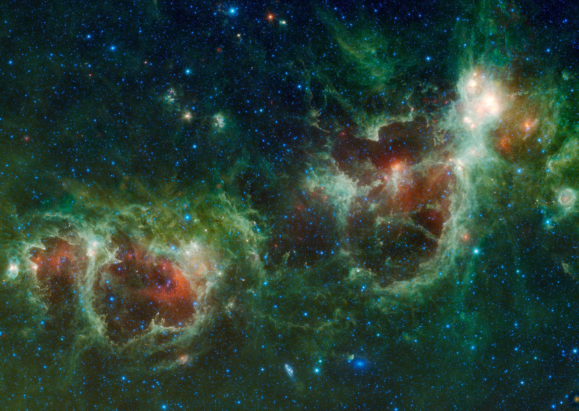 The Heart and Soul nebulae (W5, left, and W4, right) as well as NGC 896 (upper right) seen in the far infrared by the WISE observatory. Credit: NASA/JPL-Caltech/WISE Team