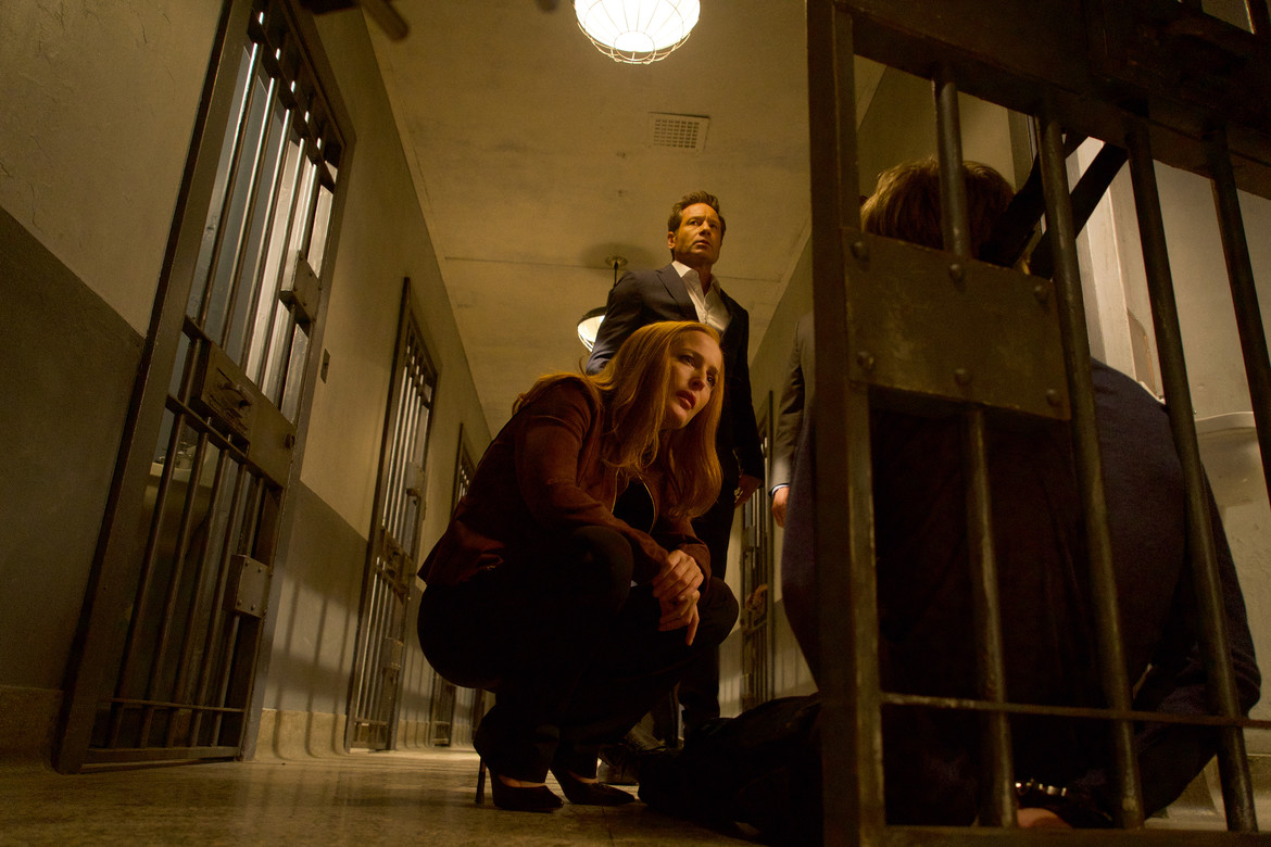 The X-Files episode 1103 Plus One Scully and Mulder over a body in prison