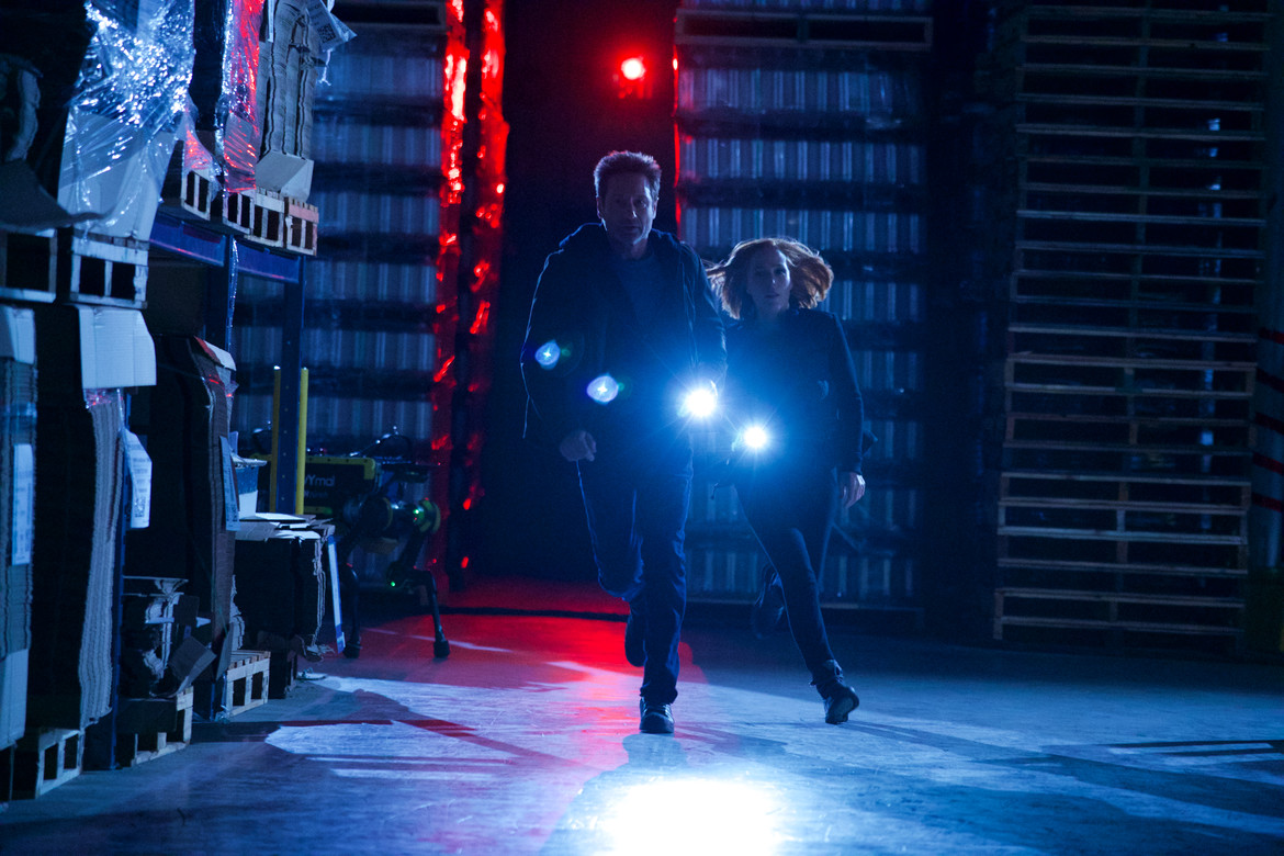 X-Files episode 1107 - Mulder and Scully running with flashlights