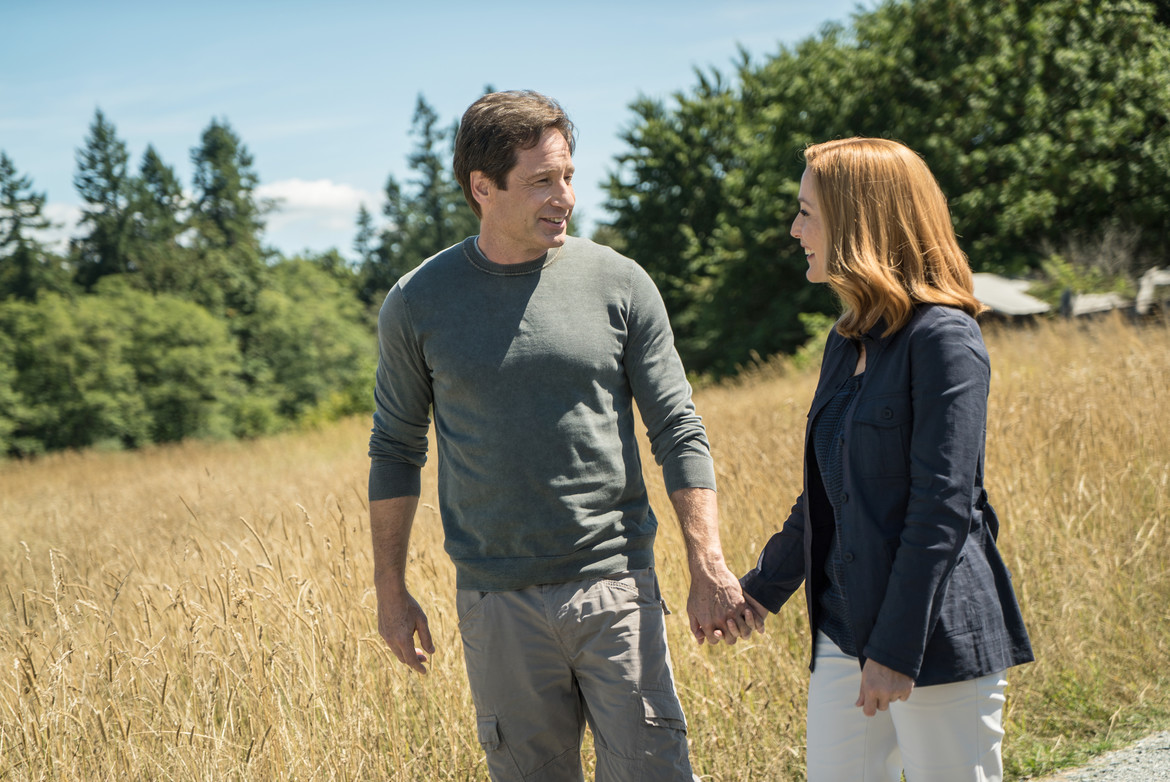 X-Files S10 episode Home Again - Mulder and Scully holding hands