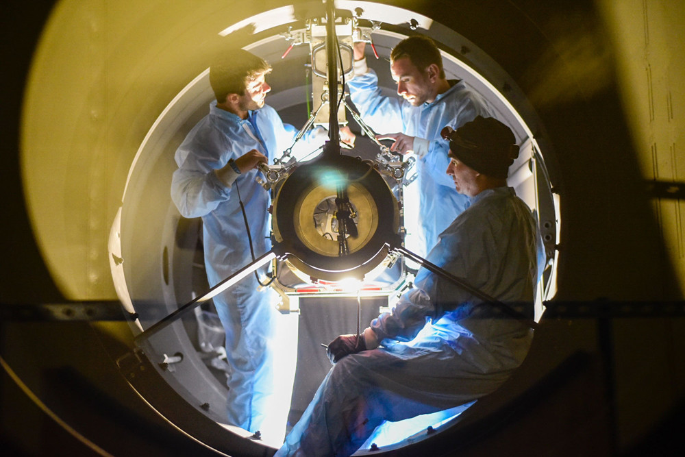 Engineers install the 65 megapixel Zwicky Transient Factory camera into the 1.3 meter Samuel Oschin Telescope at Palomar Observatory. Credit: Caltech Optical Facility
