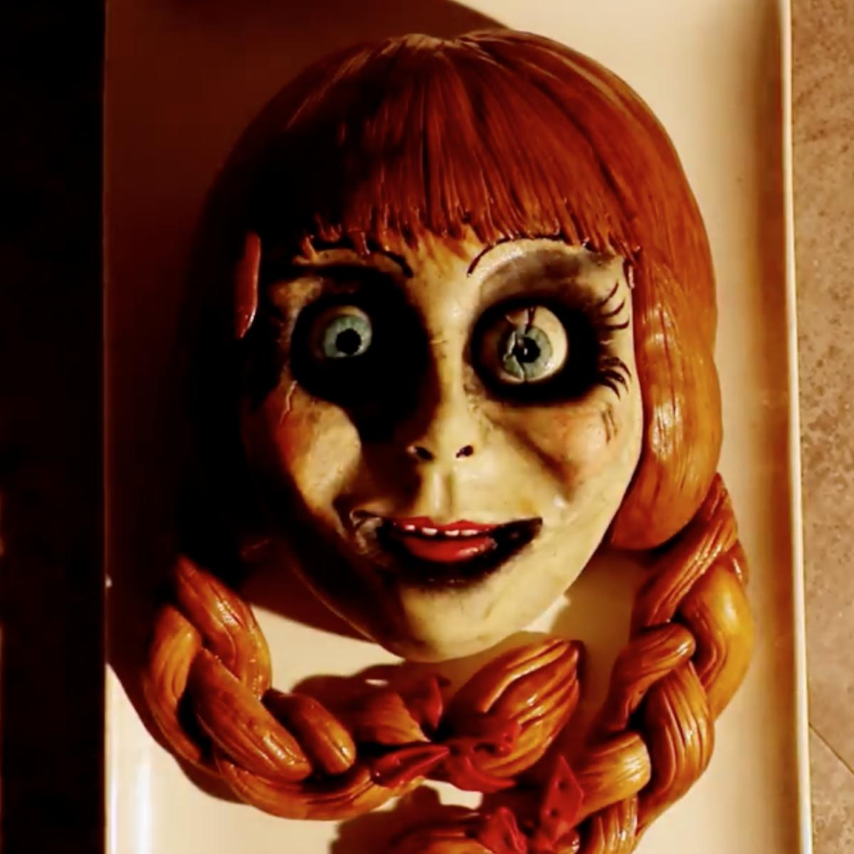 this terrifying annabelle cake is the sweet stuff of nightmares see