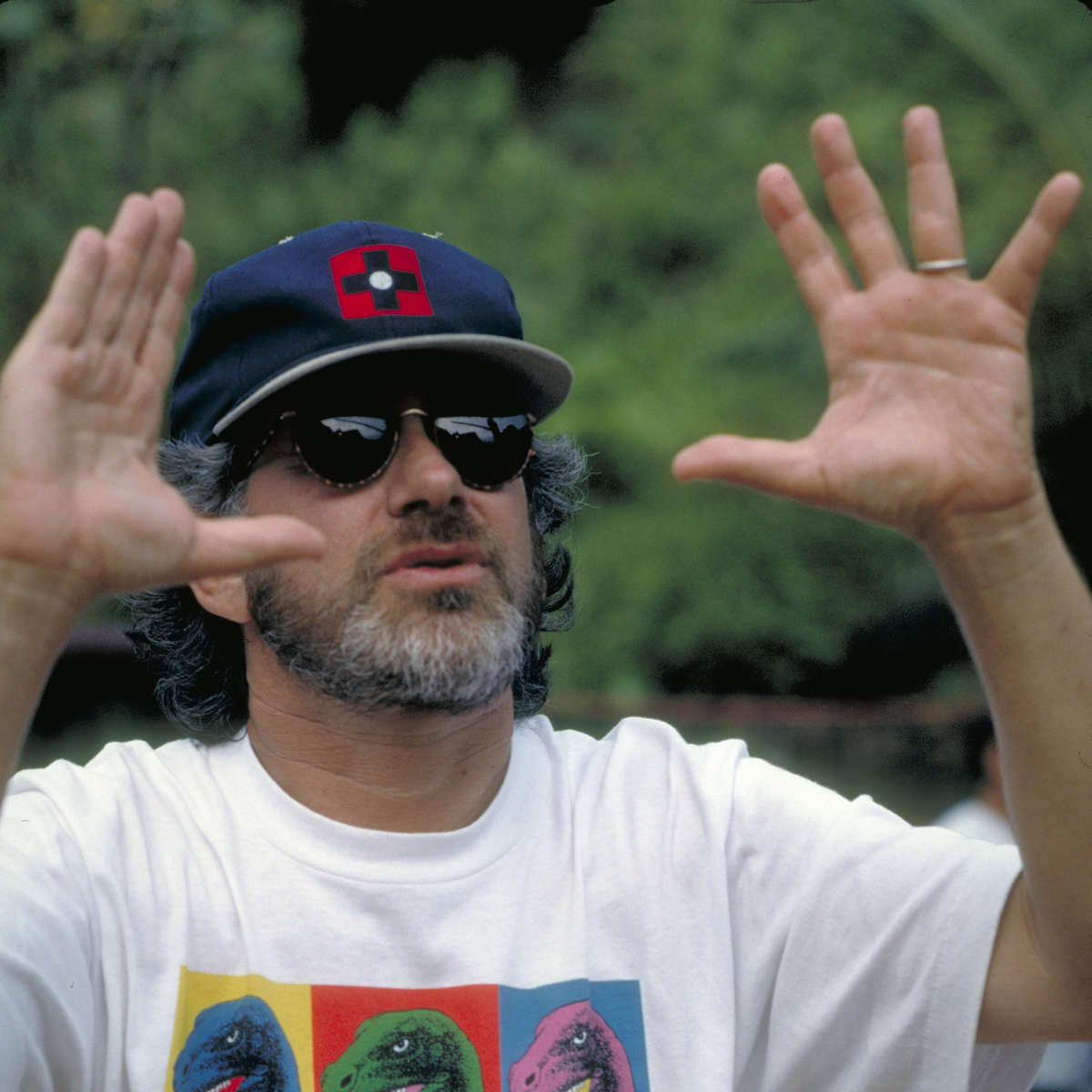 Steven Spielberg in a dinosaur t-shirt