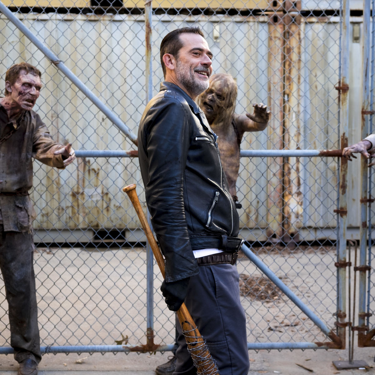 The Walking Dead episode 811 - Negan walking in front of chained zombies