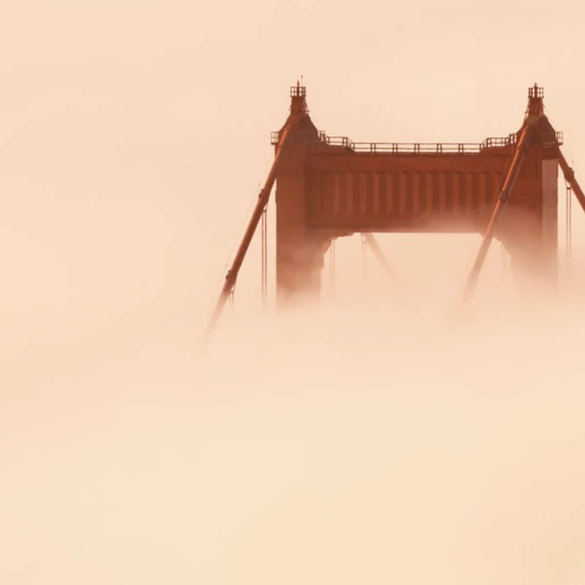 "The Golden Gate Bridge almost lost in fog flowing in from the Pacific Ocean. Taken from the video ""Adrift""."