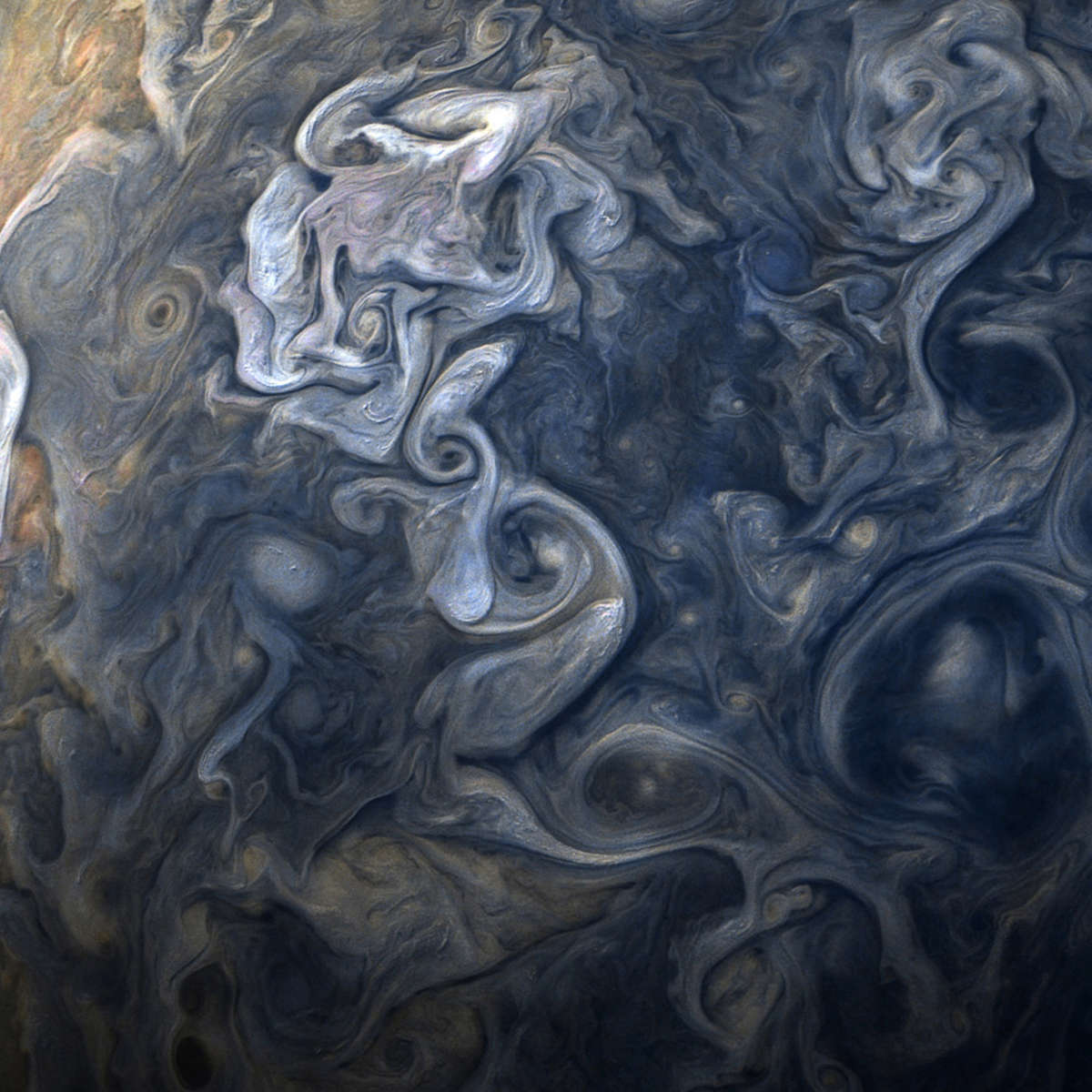 High-latitude clouds swirl and rage in this image taken from 19,000 km above Jupiter's northern latitudes. Credit: NASA / SwRI / MSSS / Gerald Eichstädt / Seán Doran