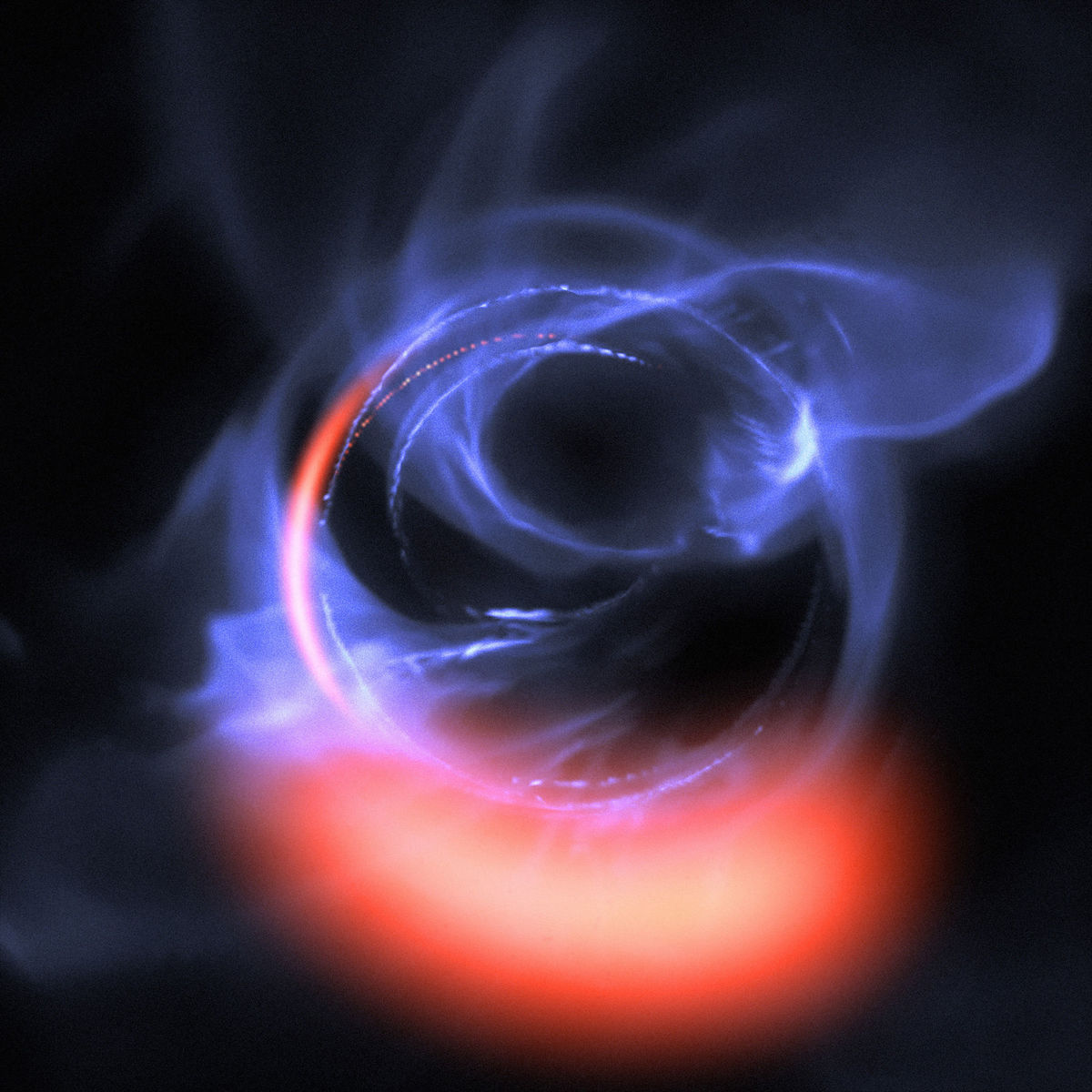 A computer simulation shows the light emitted from dust swirling at 30% the speed of light around a black hole. Incredibly strong gravity affects the path the light takes, creating the warped structure. Credit: ESO/Gravity Consortium/L. Calçada