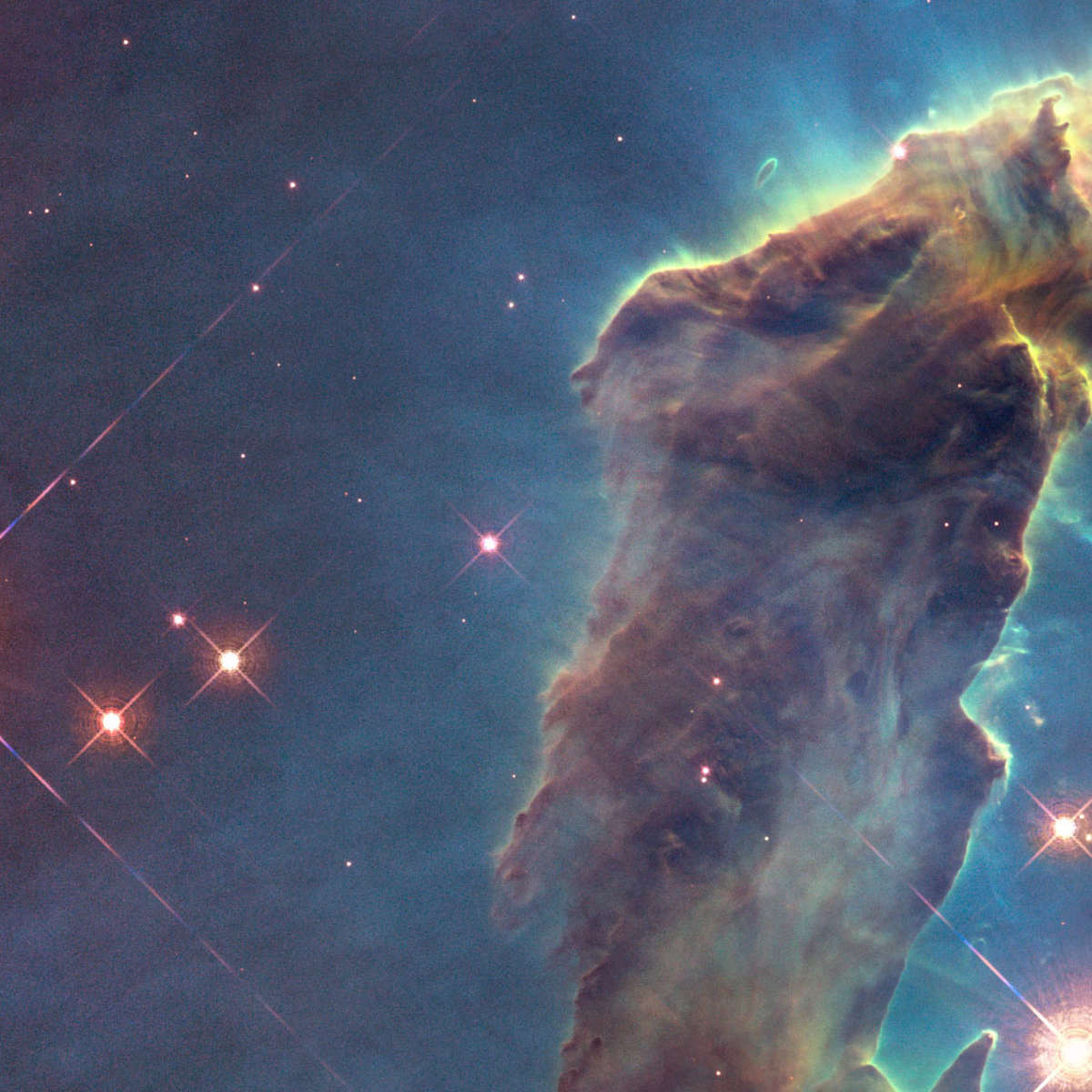 The Pillars of Creation: Towering star-forming clouds of gas and dust in the Eagle Nebula. Credit: NASA, ESA/Hubble and the Hubble Heritage Team (STScI/AURA)