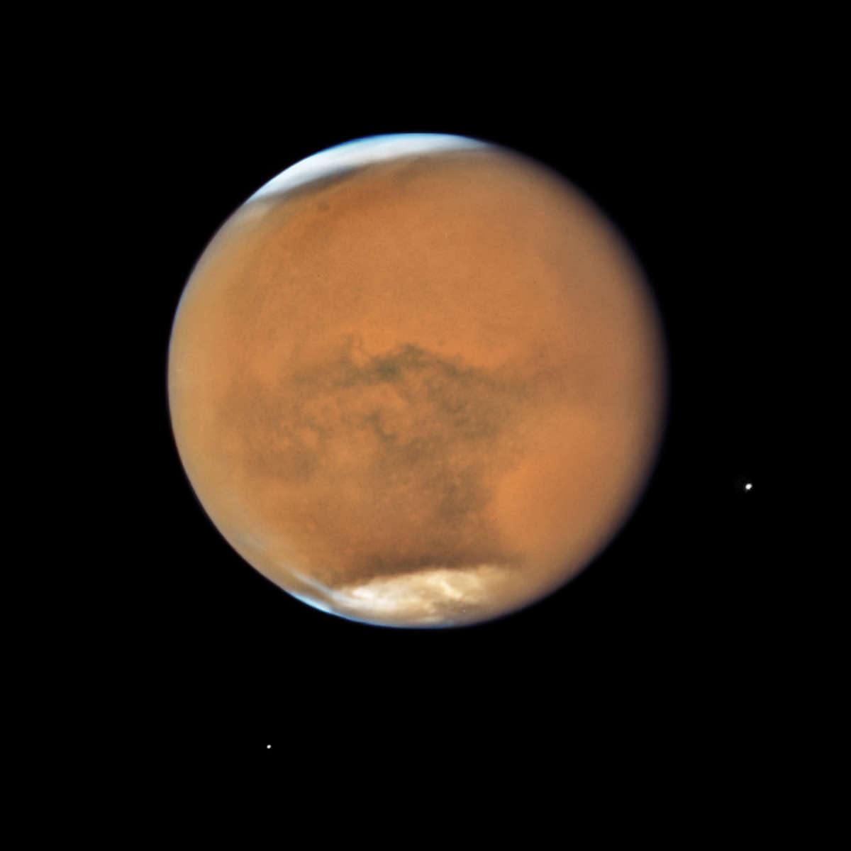 Mars, still obscured by a global dust storm, seen by Hubble on July 18, 2018. Credit: NASA, ESA, and STScI