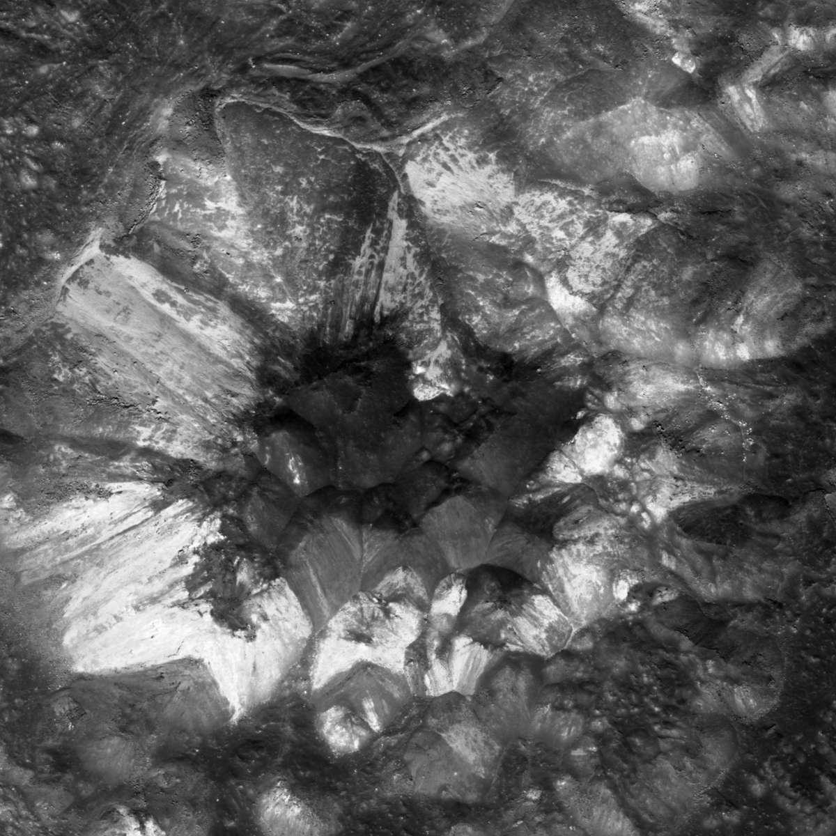 The very center of Jackson crater on the Moon is a jumbled mess of light and dark material. Credit: NASA/GSFC/Arizona State University