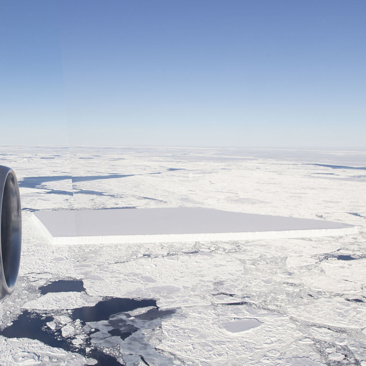 A composite of two photos shows the full extent of the trapezoidal shape of the large iceberg. Credit: NASA / Jeremy Harbeck