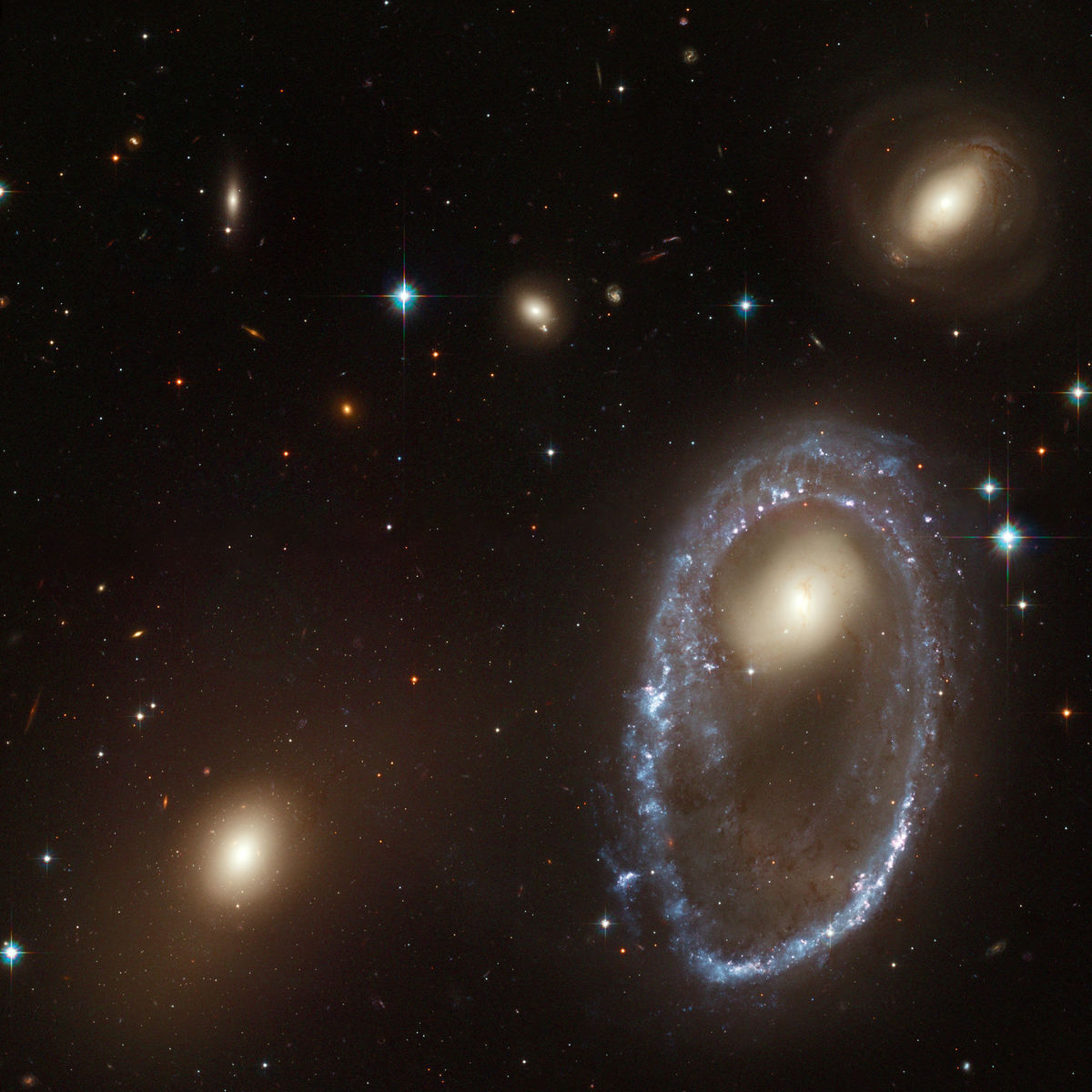 The ring galaxy AM 0644-071, created when a small compact galaxy plowed through the middle of a spiral galaxy at least tens of millions of years ago. Credit: NASA, ESA, and The Hubble Heritage Team (AURA/STScI)