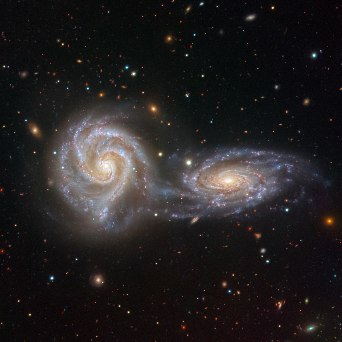 NGC 5426 (right) and NGC 5427 (left), together known as Arp 271, are close enough to each other to be interacting. Credit: ESO/Juan Carlos Muñoz​​​​​​​