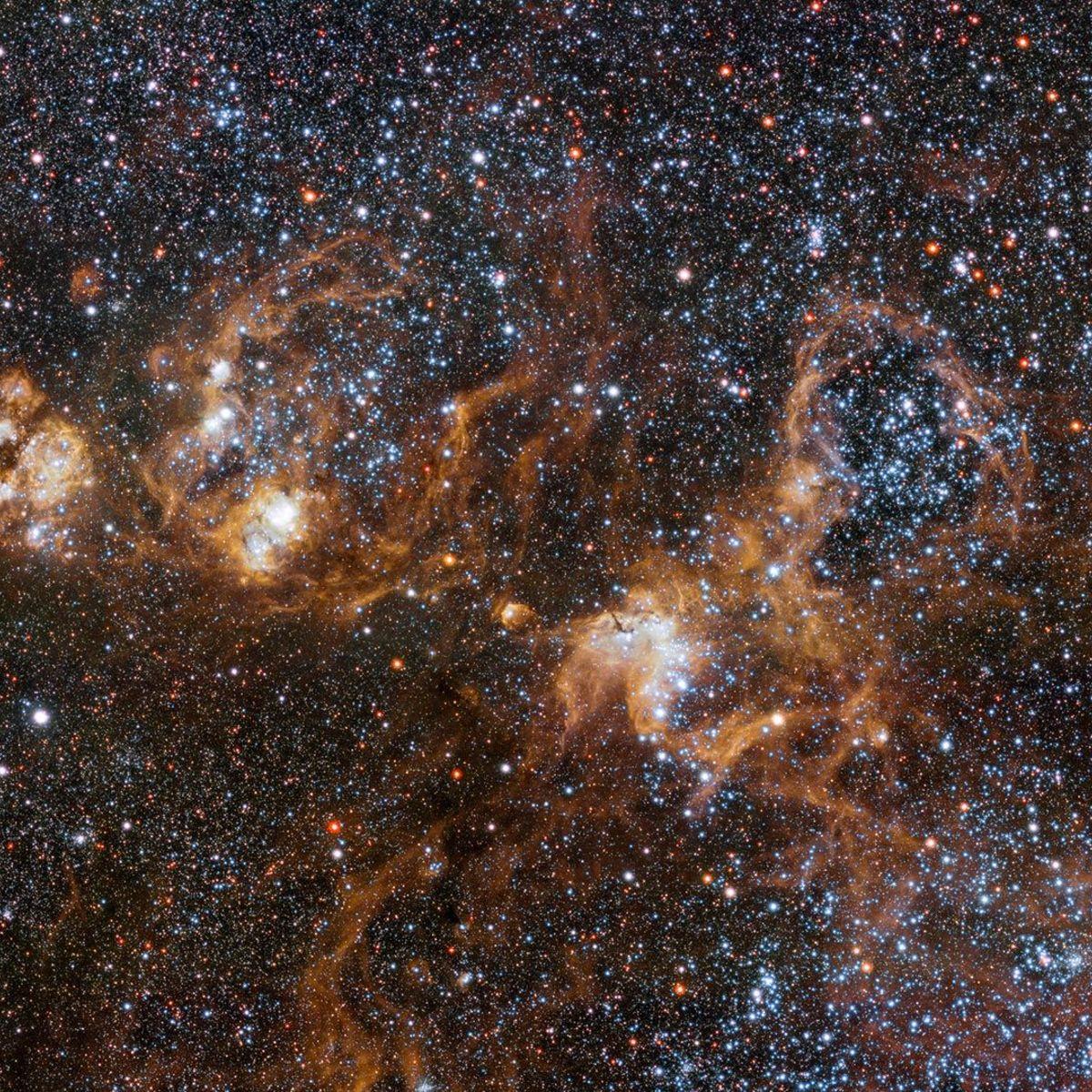 vlt_tarantula_heroThe hugely sprawling Tarantula Nebula, a vast star-forming complex in a nearby satellite galaxy of the Milky Way. Credit: ESO