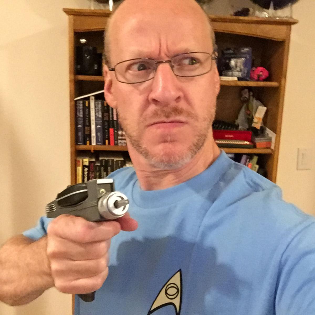Phil Plait holding a phaser