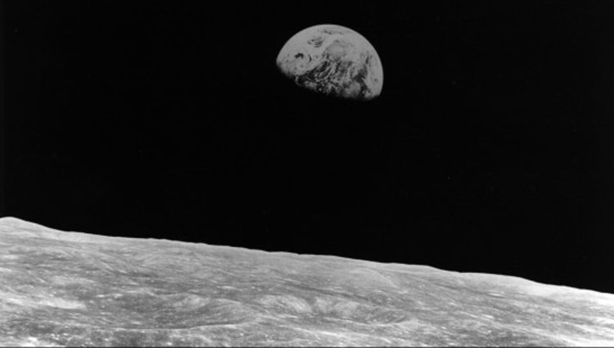 Could the mysterious mountain inside a lunar impact crater explain how life came to Earth?