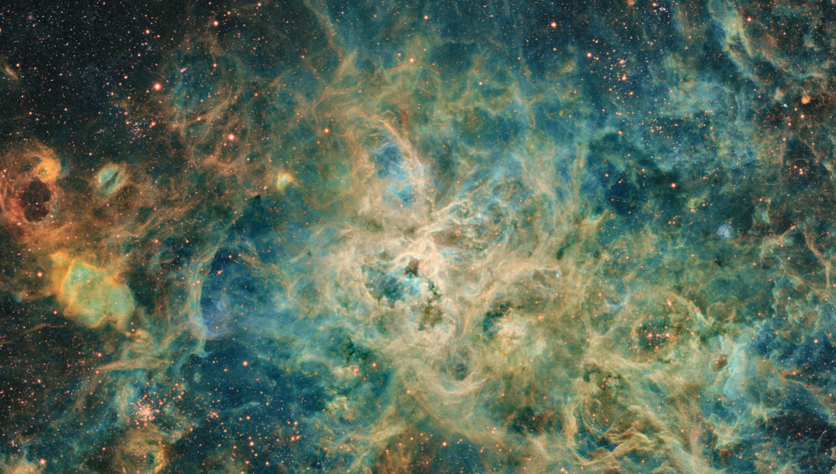 The Tarantula Nebula is a sprawling gas cloud in the Large Magellanic Cloud, and one of the largest star-forming regions in the local Universe. Credit: Jean Claude Canonne, Philippe Bernhard, Didier Chaplain, Nicolas Outters, and Laurent Bourgon