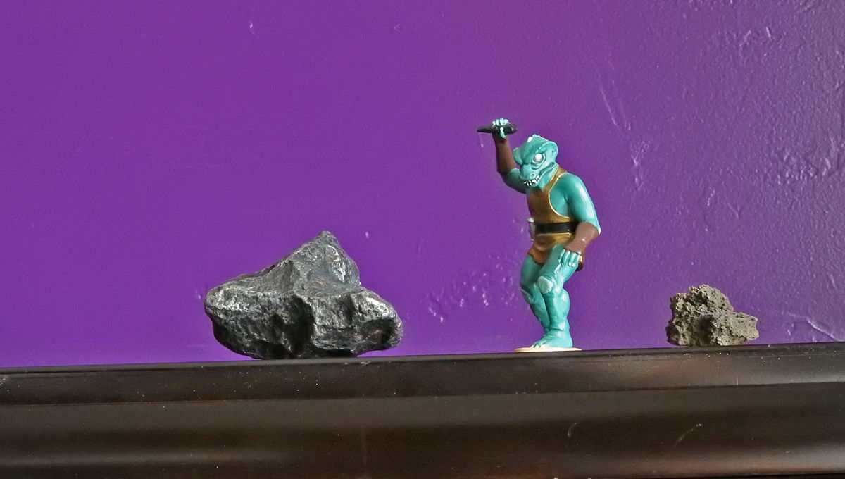 I couldn't find a good picture of an asteroid, a dinosaur, and a volcano, so please instead enjoy this photo I took of a meteorite, a Gorn, and a piece of lava. Credit: Phil Plait (reluctantly)