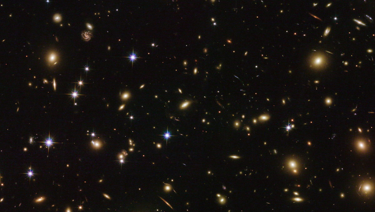 The immense galaxy cluster Abell 2163 is 2.5 billion light years away and contains hundreds of massive galaxies. Credit: ESA/Hubble & NASA