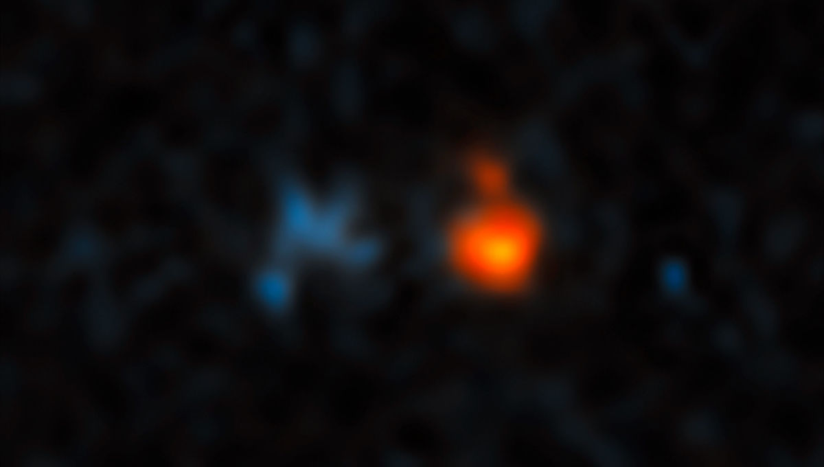 The quasar J043947.08+163415.7 (red) is extremely far away, and its light has been amplified by an intervening galaxy (blue) much closer to Earth. Credit: NASA, ESA, and X. Fan (University of Arizona)
